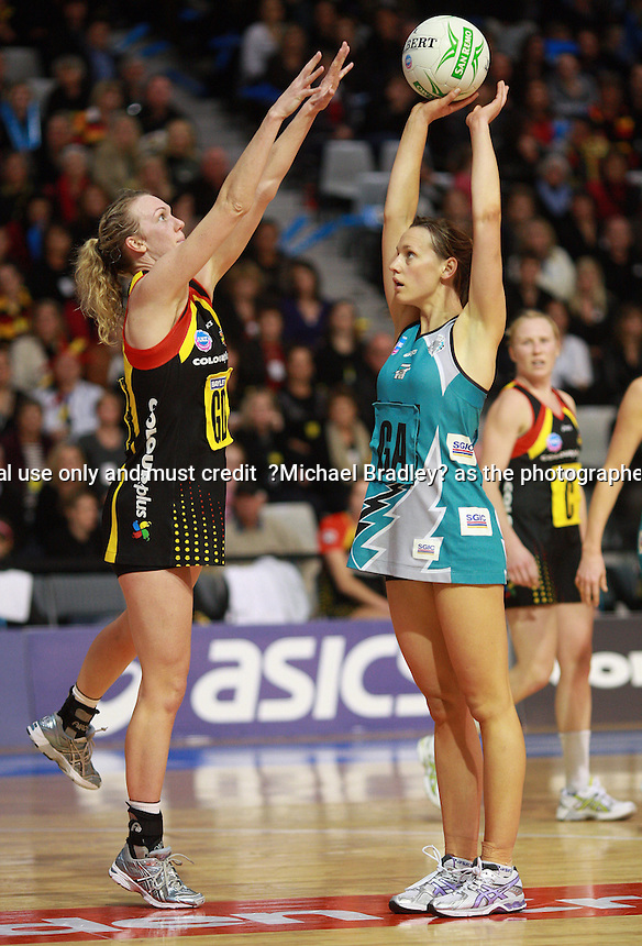 19.07.2009 Thunderbirds Natalie Medhurst and Magic's Jodi Tod in action during the ANZ Champs Netball match between the Magic v Thunderbird played at the Mystery Creek in Hamilton. Mandatory Photo Credit ©Michael Bradley.