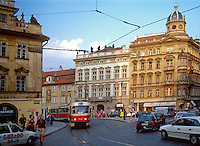 Electric tram in Malostranska Square. Mala Strana. Baroque architecture. 1031218 public transportation, street scene. Prague Bohemia Czech Republic.