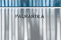 The name of the Italian island of Palmarola is printed on the deck chairs