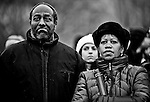 Phil Williams and Ressa Knight watch Barack Obama's speech on one of the large video screens during the Opening Inaugural Celebration at the Lincoln Memorial on Sunday morning, Jan. 18, 2009.