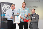 17/07/2015 The IRTE Skills Challenge 2015 prize-giving takes place at The National Motorcycle Museum, Birmingham. Sir Moir Lockhead (left) presents the Top Scoring DVSA Inspection Technician award to Ben Gilmour of Go South Coast with Dave Easton of DVSA (right).