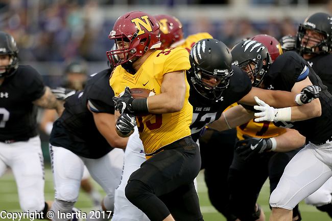SIOUX FALLS, SD - SEPTEMBER 8: Nicholas Truen #33 from Northern State looks for room past Kray Krolikowski #93 from the University of Sioux Falls in the first half of their game Saturday night at Bob Young Field in Sioux Falls. (Photo by Dave Eggen/Inertia)