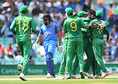 June 18th 2017, The Kia Oval, London, England;  ICC Champions Trophy Cricket Final; India versus Pakistan; Pakistan celebrate while Rohit Sharma of India leaves the field