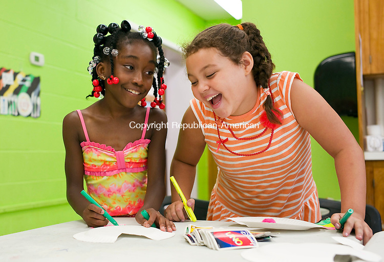 Waterbury, CT- 07 August 2015-080715CM01- Wanyahia Owens 9, left, and Alextacy Labiene 9 both of Waterbury make fish out of paper plates during the 2015 Greater Waterbury Campership Program at Girls Inc. in Waterbury on Friday.  The theme of the week was animals and the children made crafts which resembled various sea life.     Christopher Massa Republican-American