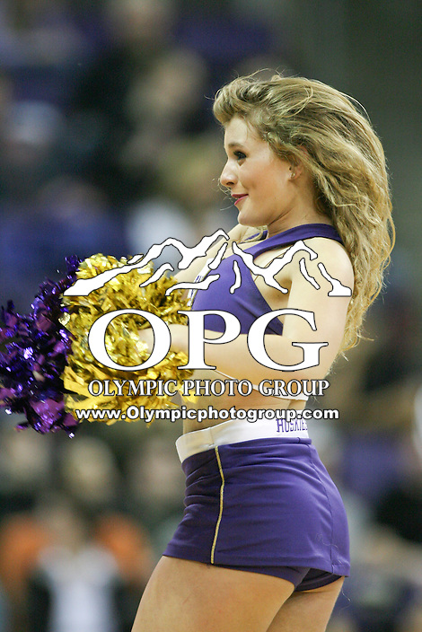 December 27, 2013:  Washington cheerleader Jordan French entertained fans during the game against Mississippi Valley.  Washington defeated Mississippi Valley 82-70 at Alaska Airlines Arena in Seattle, Washington.