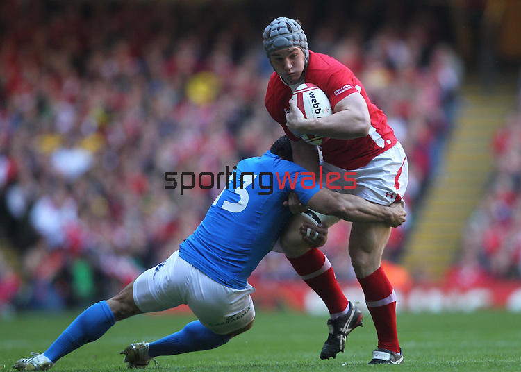 Gonzalo Canale tackles Jonathan Davies..2012 RBS 6 Nations.Wales v Italy.Millennium Stadium..10.03.12.Credit: STEVE POPE-Sportingwales
