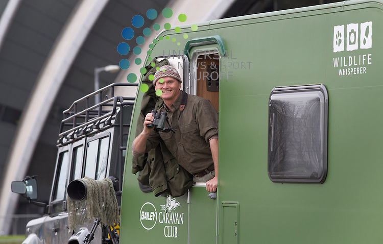 Simon King OBE, TV presenter, wildlife expert and Caravan Club celebrity member, opens the the Scottish Caravan and Motorhome show at the SECC in Glasgow. The four-day event is on from the 7 – 10 February 2013. Simon will be travelling around the west of Scotland with his Green Goddess caravan spotting wildlide as he goes..Picture: Universal News And Sport (Europe) 7 February 2013..