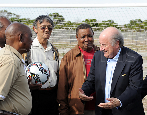 FIFA President Joseph Blatter (R) and former prisoners of Robben Island pictured during a meeting of FIFA Executive Committee off Cape Town, South Africa, 03 December 2009. Photo: Bernd Weissbrod/Actionplus - UK Editorial Use