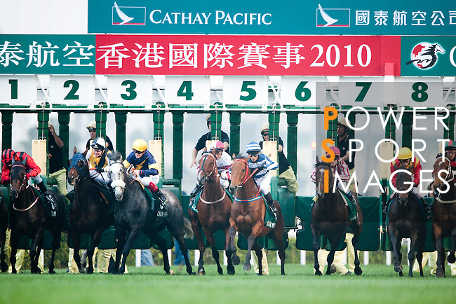 HONG KONG - DECEMBER 12:  Riders compete at the Hong Kong Cup during the Cathay Pacific International Races at the Sha Tin Racecourse on December 12, 2010 in Hong Kong, Hong Kong. Photo by Victor Fraile / The Power of Sport Images