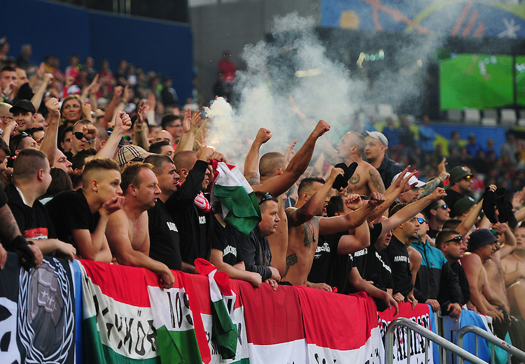 Hungary fans celebrate their sides second goal, scored by Zoltan Stieber (not in picture)<br /> <br /> Photographer Kevin Barnes/CameraSport<br /> <br /> International Football - 2016 UEFA European Championship -  Group F - Austria v Hungary - Tuesday 14th June 2016 - Stade de Bordeaux, Bordeaux, France<br /> <br /> World Copyright &copy; 2016 CameraSport. All rights reserved. 43 Linden Ave. Countesthorpe. Leicester. England. LE8 5PG - Tel: +44 (0) 116 277 4147 - admin@camerasport.com - www.camerasport.com