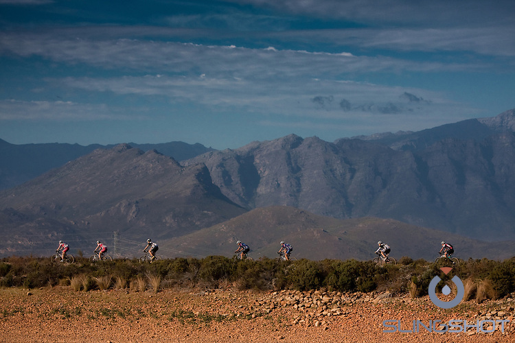 Riders make their way over a dam wall during stage four of the 2010 Absa Cape Epic Mountain Bike stage race from Ceres to Worcester in the Western Cape, South Africa on the 24 March 2010.Photo by Karin Schermbrucker/SPORTZPICS