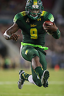 Tampa, FL - September 2, 2016: South Florida Bulls quarterback Quinton Flowers (9) leaps in for a touchdown during game between Towson and USF at the Raymond James Stadium in Tampa, FL. September 2, 2016.  (Photo by Elliott Brown/Media Images International)