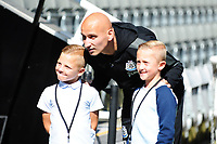 Jonjo Shelvey of Newcastle United poses for photos with young fans during Newcastle United vs Tottenham Hotspur, Premier League Football at St. James' Park on 13th August 2017