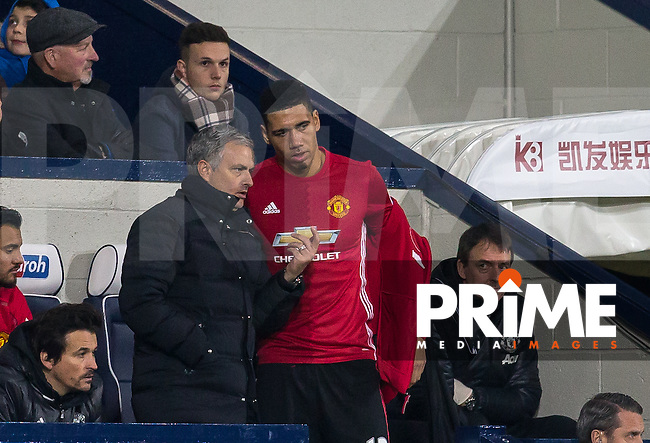 Manchester United Manager Jose Mourinho talks to substitute Chris Smalling of Manchester United during the EPL - Premier League match between West Bromwich Albion and Manchester United at The Hawthorns, West Bromwich, England on 17 December 2016. Photo by Andy Rowland / PRiME Media Images.