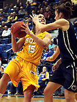 BROOKINGS, SD - DECEMBER 11:  Steph Paluch #15 from South Dakota State University takes the ball tot he basket against Maggie Lucas #33 from Penn State in the first half of their game Wednesday night at Frost Arena in Brookings. (Photo by Dave Eggen/Inertia)