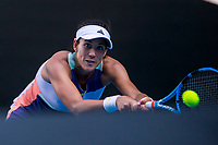30th January 2020; Melbourne Park, Melbourne, Victoria, Australia; Australian Open Tennis, Day 11; Garbine Muguruza of Spain returns the ball during the semifinals of the 2020 Australian Open on January 30 2020, at Melbourne Park in Melbourne, Australia. (Photo by Jason Heidrich/Icon Sportswire)
