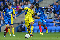 Wes Thomas of Oxford United (centre) under pressure from Leo Da Silva Lopes of Peterborough United during the Sky Bet League 1 match between Peterborough and Oxford United at the ABAX Stadium, London Road, Peterborough, England on 30 September 2017. Photo by David Horn.