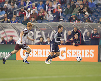 New England Revolution forward Benny Feilhaber (22) dribbles as Colorado Rapids midfielder Jeff Larentowicz (4) closes. In a Major League Soccer (MLS) match, the New England Revolution tied the Colorado Rapids, 0-0, at Gillette Stadium on May 7, 2011.