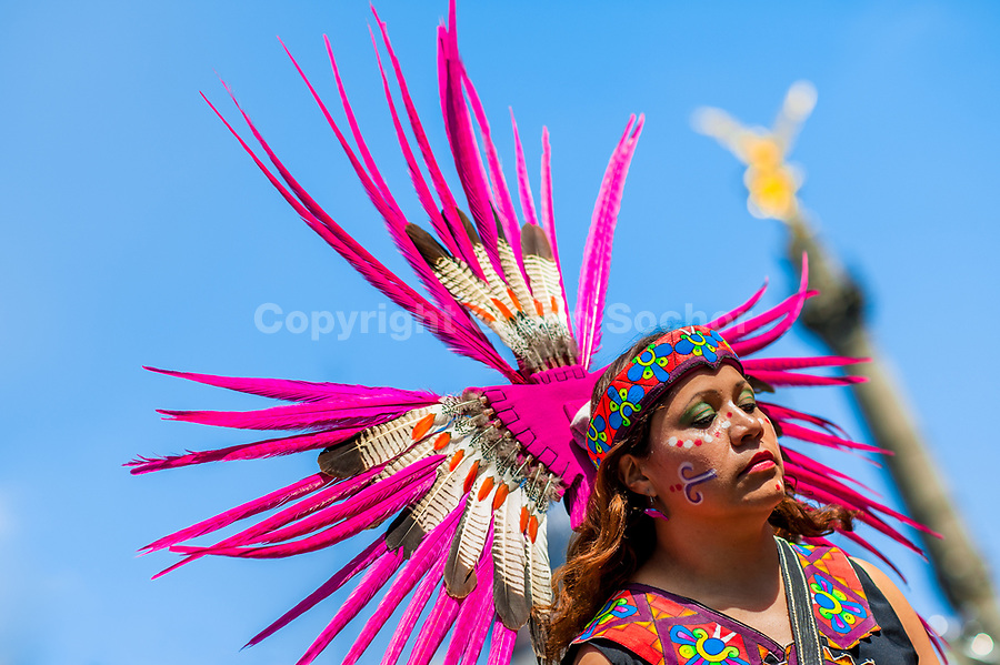 A Mexican woman, wearing a large feather headgear inspired by Aztecs, takes part in the Day of the Dead festivities in Mexico City, Mexico, 29 October 2016. Day of the Dead (Día de Muertos), a syncretic religious holiday combining the death veneration rituals of the ancient Aztec culture with the Catholic practice, is celebrated throughout all Mexico. Based on the belief that the souls of the departed may come back to this world on that day, people gather at the gravesites in cemeteries praying, drinking and playing music, to joyfully remember friends or family members who have died and to support their souls on the spiritual journey.