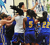 Kellenberg varsity girls basketball teammates hoist Clare Calabro #10, top, into the air after she hit a long-range three-pointer to lift the Lady Firebirds to a dramatic 48-47 win over host Our Lady of Mercy Academy in a CHSAA league game on Friday, Jan. 13, 2017.