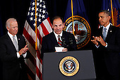 With United States Vice President Joseph Biden, left,  looking on, United States President Barack Obama, right, announces his intention to nominate Robert McDonald, retired Chairman, President and CEO of Procter & Gamble, to be Secretary of the Department of Veterans Affairs in Washington, D.C. on June 30, 2014.  <br /> Credit: Dennis Brack / Pool via CNP