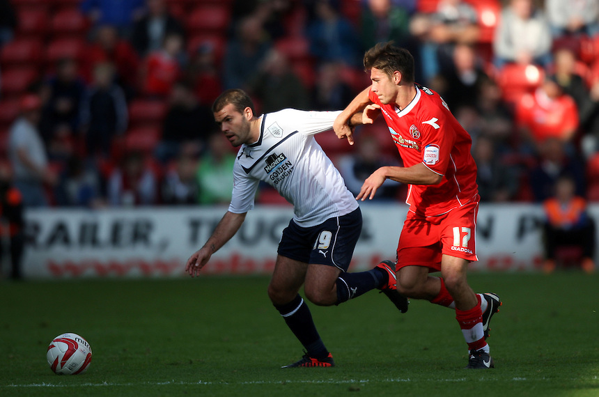 Preston North End's John Welsh battles with Walsall's George Bowerman ..Football - npower Football League Division One - Walsall v Preston North End - Saturday 22nd September 2012 - Banks's Stadium - Walsall..