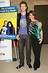 American Idol's Paula Abdul gives a Guide Dog to blind American Idol contestant Scott MacIntrye as part of the official kick-off of May as National Guide Dog Month at Guide Dogs of America in Sylmar, California on May 08,2009                                                                     Copyright 2009 Debbie VanStory / RockinExposures