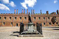 The statue of the school's founder, Henry VI, stands in the main courtyard of Eton College.