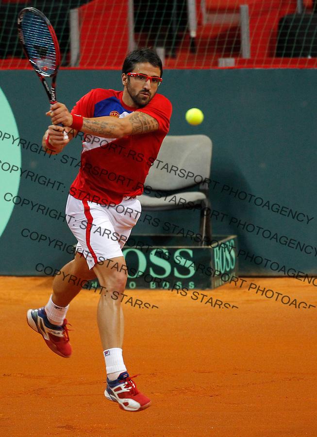 Tennis Tenis<br /> Davis Cup semifinal polufinale<br /> Serbia v Canada<br /> Janko Tipsarevic v Vasek Pospisil<br /> Janko Tipsarevic returns the ball<br /> Beograd, 15.09.2013.<br /> foto: Srdjan Stevanovic/Starsportphoto &copy;