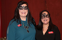 NWA Democrat-Gazette/CARIN SCHOPPMEYER Kimberly <br /> Gatlin and Christine Doellinger volunteer at the seventh annual Moonlight Masquerade to benefit the Junior League.