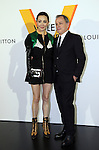 """April 21, 2016, Tokyo, Japan - Hong Kong actress Carina Lau smiles with Louis Vuitton chairman and CEO Michael Burke during a photo call for the reception of Louis Vuitton's art exhibition in Tokyo on Thursday, April 21, 2016. French luxury barnd Luis Vuitton will hold the exhibition """"Volez, Voguez, Voyagez"""" in Tokyo from April 23 through June 19.  (Photo by Yoshio Tsunoda/AFLO) LWX -ytd-"""