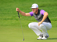Oliver Fisher (ENG) lines up his putt on the 9th green during Sunday's Final Round of the 2014 BMW Masters held at Lake Malaren, Shanghai, China. 2nd November 2014.<br /> Picture: Eoin Clarke www.golffile.ie