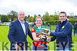 David Randle right and County Chairman Sean Walsh presents the cup to Kilcummin captain Aine O'Donoghue after defeating the Milltown/Listry in the CCF Junior A final in Killarney on Sunday