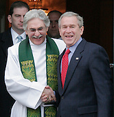 Washington, D.C. - February 11, 2007 -- United States President George Bush, shakes hands with Reverend Luis Leon following church services at St. Johns Episcipal Church in Washington DC February 9, 2007. <br /> Credit: Ken Cedeno - Pool via CNP