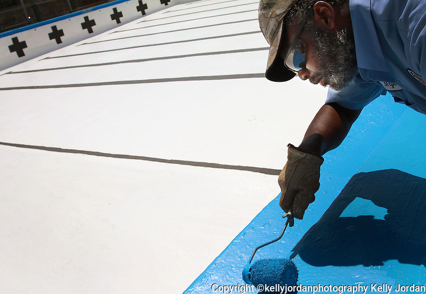 Kelly.Jordan@jacksonville.com--050311--City of Jacksonville Department of Parks, Recreation and Entertainment employee Major Parker puts the finishing touches on a week-long swimming pool repainting project at  Julius Guinyard Park and Pool on Jefferson Street in Jacksonville Tuesday May 3, 2011. The pool, the largest in Jacksonville, gets a new paint job once a year and will be open in time for the summer swimming season. (The Florida Times-Union, Kelly Jordan)