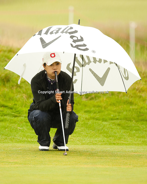 Leader, Meena Lee looks unsure of her line on the 16th green during the first round play of the  Ricoh Woman's British Open to be played over the Championship Links from 28th to 31st July 2011; Picture Stuart Adams, SAFOTO. www.safoto.co.uk; 28th July 2011