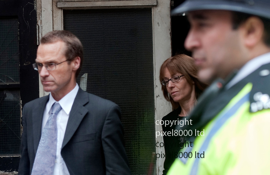 Gareth Williams - MI6 body in holdall  inquest..Family members leave court. -.. father Ian, left and mother Ellen, right, leave after the verdict. 2.5.12.......Pic by Gavin Rodgers/Pixel 8000 Ltd