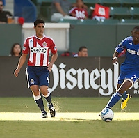Chivas defender Michael Umana (4) passes the ball during the first half of the game between Chivas USA and the Kansas City Wizards at the Home Depot Center in Carson, CA, on September 19, 2010. Final score Chivas USA 0, Kansas City Wizards 2.