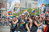 WNBA women's basketball workers and supporters in the annual Lesbian, Gay, Bisexual,Transgender and Queer (LGBTQ) Pride Parade on Fifth Avenue in New York on Sunday, June 25, 2017. Besides the corporate sponsors, politicians and various social service groups many participants carried political themed signs showing their dissatisfaction with President Trump. (© Richard B. Levine)