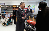 United States President Barack Obama talks with student Alexandria Sutton, 16, about her project while visiting a classroom at Thomas Jefferson High School for Science and Technology September 16, 2011 in Alexandria, Virginia. Later in the morning Obama signed the America Invents Act, which reforms patent law so to give a patent to the first applicant rather than the first inventor and allows the woefully underfunded U.S. Patent and Trade Office to set and potentially keep its own fees. .Credit: Chip Somodevilla / Pool via CNP