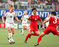 Santiago, Chile: American player, Michelle Enyeart(R) goes for the ball along with Kim Chun Hui(L)  Korea DRP's  team, during the finals match, of the Fifa U-20 Womens World Cup the at Florida´s Municipal Stadium, on December 07 th, 2008. By Grosnia / ISIphotos.com.