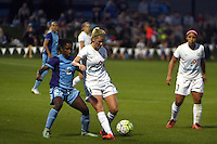 Kansas City, MO - Saturday May 28, 2016: FC Kansas City defender Katie Bowen (21) defends against Orlando Pride midfielder Jasmyne Spencer (23). FC Kansas City defeated Orlando Pride 2-0 during a regular season National Women's Soccer League (NWSL) match at Swope Soccer Village.