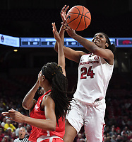 NWA Democrat-Gazette/J.T. WAMPLER Arkansas' Taylah Thomas gets her shot broken up against Houston Thursday March 21, 2019 at Bud Walton Arena in Fayetteville during the first round of the Women's National Invitational Tournament. Arkansas won 88-80 in overtime. The Razorbacks take on University of Alabama at Birmingham at home on Sunday.