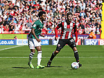 Rico Henry of Brentford in action with Kieron Freeman of Sheffield Utd during the English championship league match at Bramall Lane Stadium, Sheffield. Picture date 5th August 2017. Picture credit should read: Jamie Tyerman/Sportimage