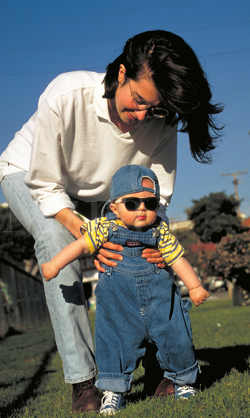 Mother, Christine, walks with baby Alexander in the park, babies, boy, boys. Alexander and Mom. Santa Monica California.