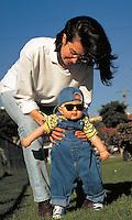 Mother, Christine, walks with baby Alexander in the park, babies, boy, boys. Alexander and Mom. Santa Monica California.