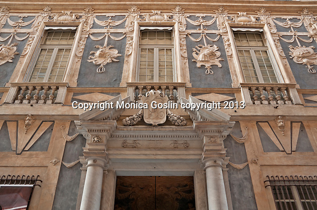 Facade of one of the ancient palaces on Via Garibaldi, a street in the historic center that is lined with palaces and the street dates back to 1550; many of the palaces are now museums and galleries