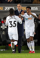 Swansea manager Paul Clement (C) watches on as Renato Sanches of Swansea City (L) is substituted by Leroy Fer during the Premier League match between Swansea City and Bournemouth at The Liberty Stadium, Swansea, Wales, UK. Saturday 25 November 2017