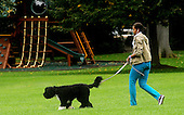 Washington, DC - September 26, 2009 -- First Lady Michelle Obama walks the family dog Bo, on the South Lawn of the White House after returning from daughter Malia's soccer game on Saturday, September 26, 2009  in Washington D.C. .Credit: Olivier Douliery  / Pool via CNP
