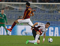 Leverkusen's Kyriakos Papadopoulos challenges  AS Roma's Mohamed Salah  during the Champions League Group E soccer match between As Roma and  Bayer Leverkusen at the Olympic Stadium in Rome, November 04 2015